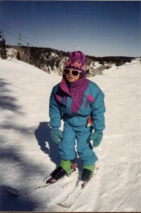 This is me the very first time I ever skied, at age four. Look at my sweet dinosaur hat. Could I still rock a onesie today, you ask? Let's just say some things, like great fashion sense, stick with a person for life.
